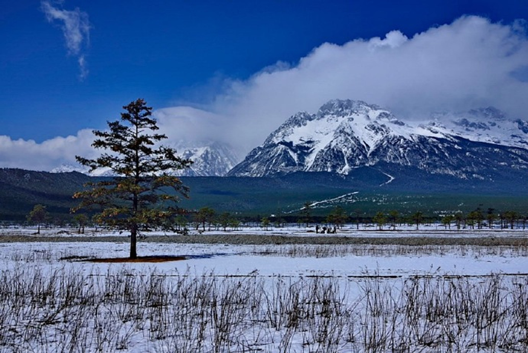 夏天到丽江,一定要去玉龙雪山感受下冰火两重天的感觉